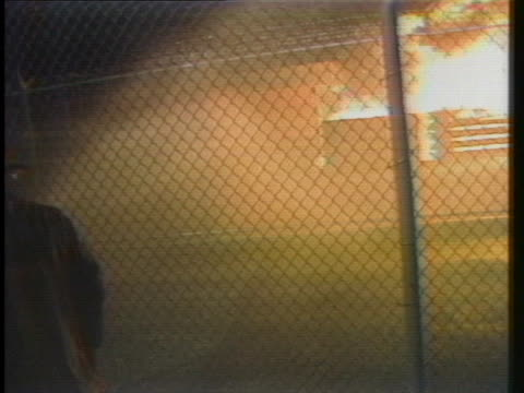 firefighters try to put out a blaze at idaho's state penitentiary, started when negotiations failed with prisoners holding a prison guard. - prison guard stock videos & royalty-free footage