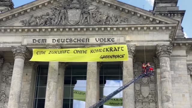 firefighters try to remove the banner unfurled from the roof of bundestag by greenpeace activists to protest against germany's electricity production... - rippled stock videos & royalty-free footage