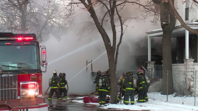 wgn firefighters use hose against house emitting plumes of smoke on dec 26 2017 - emitting stock videos & royalty-free footage