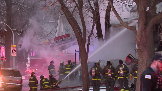 wgn firefighters use hose against house emitting plumes of smoke on dec 26 2017 - fire hose stock videos and b-roll footage