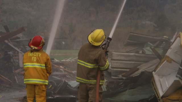 firefighters using high pressure hoses - myrtle creek stock videos and b-roll footage