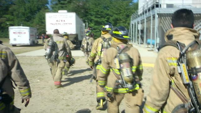 ms pov firefighters walking in fire uniforms, ecuador - dreiviertelansicht stock-videos und b-roll-filmmaterial