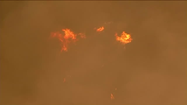 firefighters were battling a wildfire in the hills along the 91 freeway on the far eastern edge of anaheim on monday, and there's concern that winds... - distant stock videos & royalty-free footage