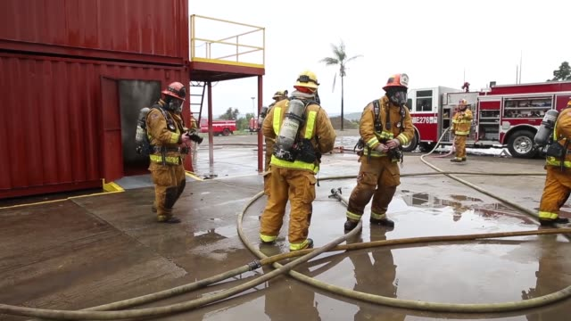 firefighters with los angeles county fire department and fire station one camp pendleton fire department conduct a joint fire control training... - fire station stock videos & royalty-free footage