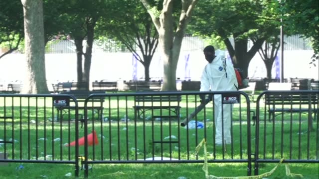 firefighters work on a smoldering fire as a crew starts cleaning up lafayette square near the white house following a night of confrontations between... - lafayette square washington dc stock videos & royalty-free footage