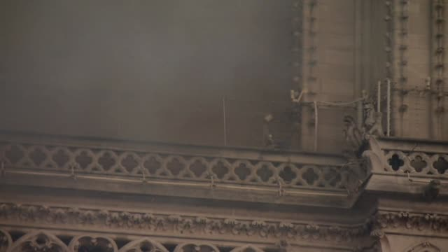 firefighters working amid the notre dame cathedral fire - architecture stock videos & royalty-free footage