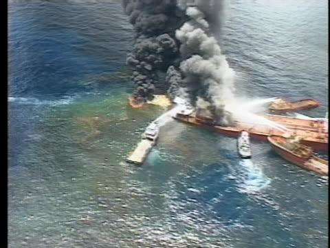 firefighting boats attempt to put out the flames on a burning super tanker - environment or natural disaster or climate change or earthquake or hurricane or extreme weather or oil spill or volcano or tornado or flooding stock videos & royalty-free footage