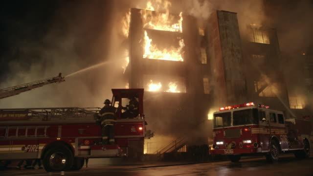 ws, cs, firefighting crew extinguishing blaze with hoses, brooklyn, new york city, new york, usa - fire engine stock videos & royalty-free footage