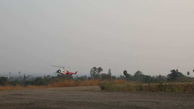 firefighting helicopter landing after action. the u.s. west is bracing for another blast of dry and windy weather, threatening to stoke wildfires... - sierra madre stock-videos und b-roll-filmmaterial