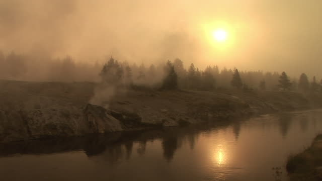 stockvideo's en b-roll-footage met ws, firehole river surrounded with geysers at sunrise, upper geyser basin, yellowstone national park, wyoming, usa - cross processen