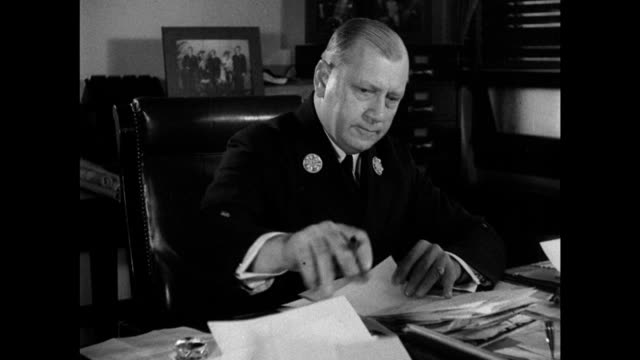 firehouse int ms fire comm john j mcelligot at desk ws police precinct int ms fiorello laguardia w/ police comm louis j valentine 'a cop ought to run... - fire department of the city of new york stock videos and b-roll footage