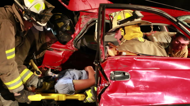fireman at rescue - road accident stock videos & royalty-free footage