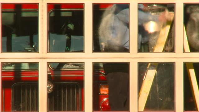 vídeos y material grabado en eventos de stock de ms pan fireman cleaning garage windows at fire station/ richmond, virginia - parque de bomberos