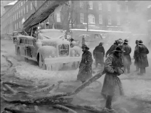 fireman coiling frozen hoses disentangling hoses stuck in snow firemen pumping water into building firefighting in the canadian winter on january 01... - frozen water stock videos & royalty-free footage