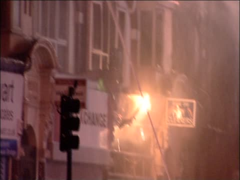 fireman fighting blaze at a building in croydon following riots in the area, august 2011 - ロンドン クロイドン点の映像素材/bロール
