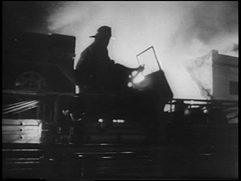 fireman in truck in front of burning building at night / detroit race riots - 1967 stock videos & royalty-free footage