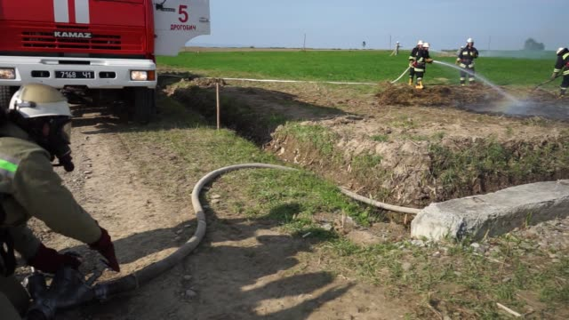 ** mute ** a fireman runs across field as he takes part in an antiterrorism exercise held near the opary underground gas storage facility operated by... - kopfbedeckung stock-videos und b-roll-filmmaterial