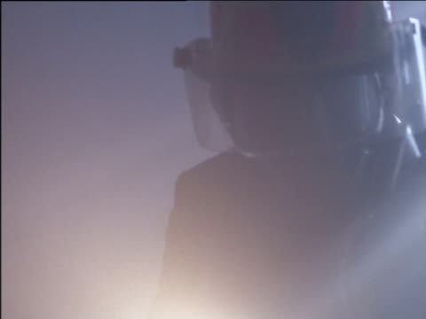 fireman searching in smoky room using electric torch to see - electric torch stock videos & royalty-free footage
