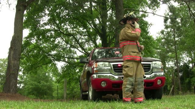 fireman talks on his radio - radio stock videos & royalty-free footage
