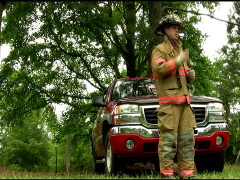 Fireman talks on his radio