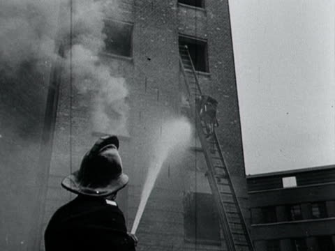 fireman uses a hose to tackle a fire in a tower during a training demonstration. - fire hose stock videos & royalty-free footage