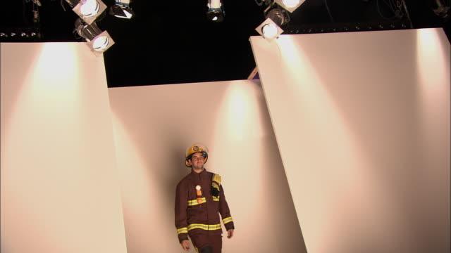 la ms fireman walking on catwalk during fashion show/ london, england - この撮影のクリップをもっと見る 1064点の映像素材/bロール