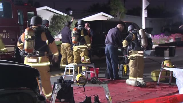 firemen at house explosion scene on april 15, 2013 in costa mesa, california - costa mesa stock videos & royalty-free footage