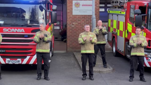 firemen at the knightswood fire department in scotland clap for health workers working on the frontlines in the coronavirus pandemic - 18 19 years stock videos & royalty-free footage