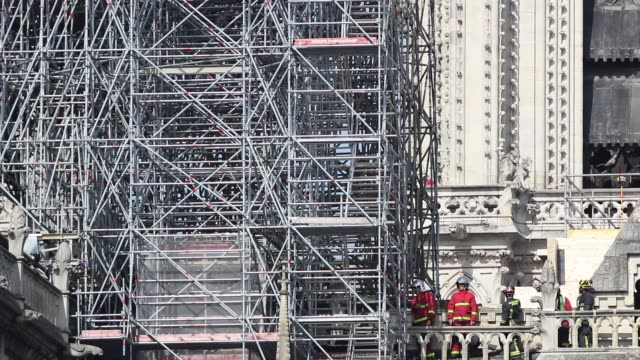 firemen carry out inspections at notredame cathedral following a major fire on april 16 2019 in paris france / a fire broke out on monday afternoon... - spire stock videos & royalty-free footage