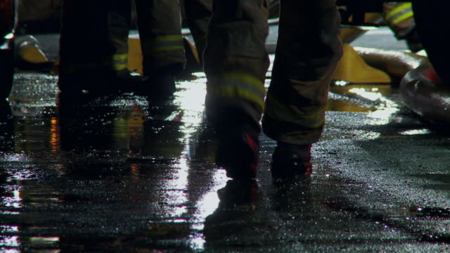 firemen feet silhouette 01 - rescue worker stock videos and b-roll footage