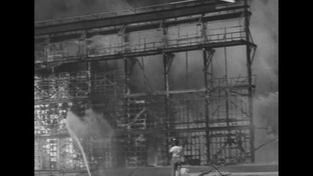 firemen fight a massive fire at warner brothers studios in burbank. - バーバンク点の映像素材/bロール