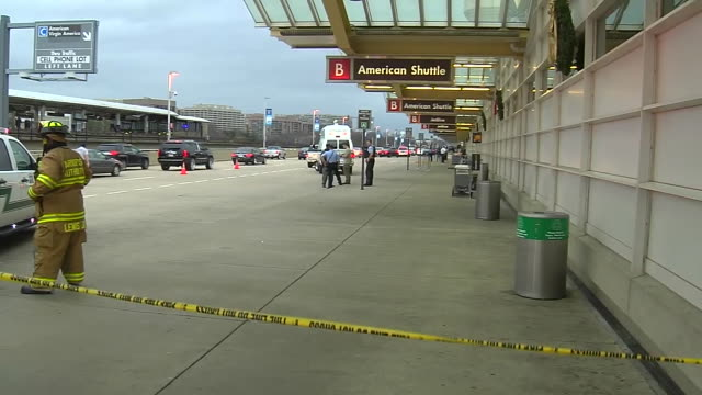 firemen patrolling outside reagan national airport after report of suspicious package. - ロナルド レーガン ワシントン国際空港点の映像素材/bロール