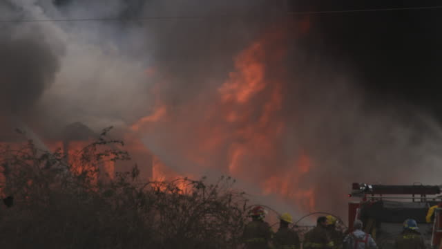 firemen shoot powerful streams of water on a raging house fire - myrtle creek stock videos and b-roll footage