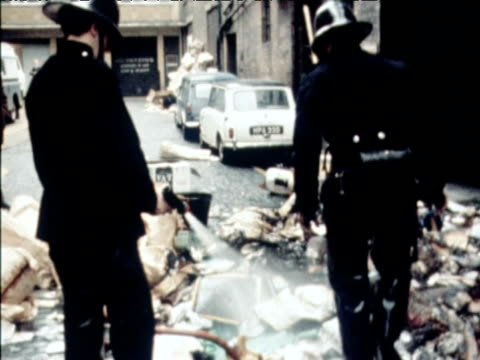 firemen sweep up rubbish during dustmens strike soho london 1970 - employment issues stock videos & royalty-free footage