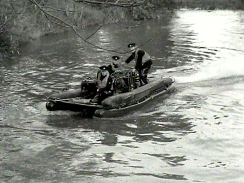 firemen test a new inflatable raft which is powered by engines and a fire hose - fire hose stock videos and b-roll footage