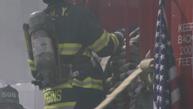 cu, td, firemen unloading hoses from fire truck, new york city, new york, usa - fire engine stock videos & royalty-free footage