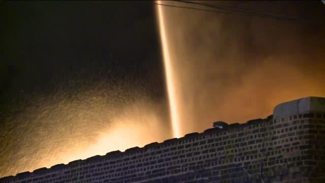 firemen using hoses on fire on july 02, 2013 in chicago, illinois - 緊急用具点の映像素材/bロール