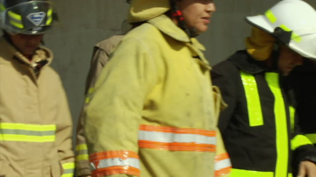 ms selective focus firemen walking, outdoors, ecuador - ecuador stock videos and b-roll footage