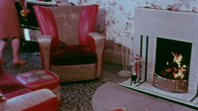 1967 montage fireplace burning in modern living room / handsworth, west midlands, england - handsworth stock videos & royalty-free footage