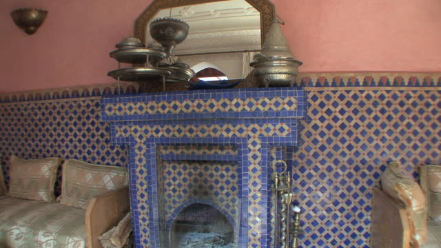 ms td fireplace in riad ground floor room, marrakech, morocco - film tilt stock videos & royalty-free footage