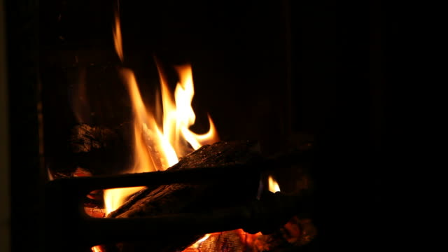 fireplace mid shot with copy-space on black - briquette stock videos & royalty-free footage