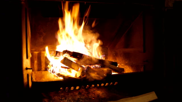 fireplace with fire burning - stone object stock videos & royalty-free footage