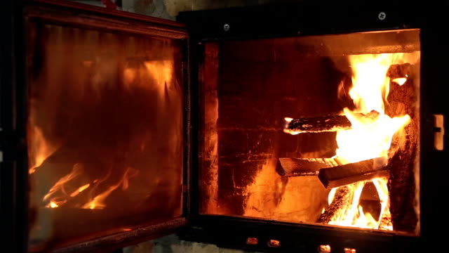 fireplace with the door open. - furnace stock videos & royalty-free footage