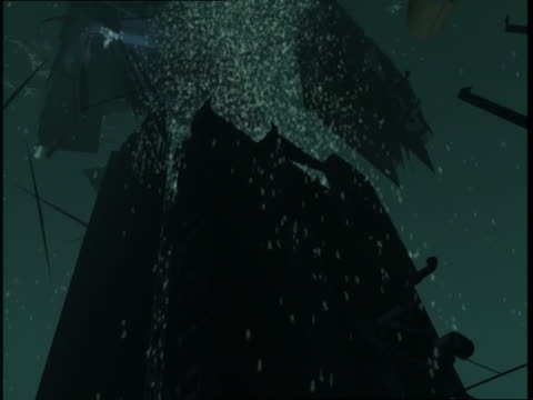 fires burn in rms titanic as sections of the ship sink toward the seafloor. - wrack stock-videos und b-roll-filmmaterial