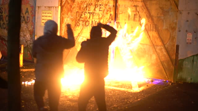 fires started by rioters at peace line in lanark way, between shankhill and springfield roads, in belfast, as tensions between loyalist and... - fire natural phenomenon stock videos & royalty-free footage