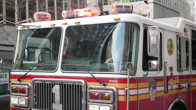 firetruck getting emergency call in the city. new york city fire department vehicle - fire department of the city of new york stock-videos und b-roll-filmmaterial