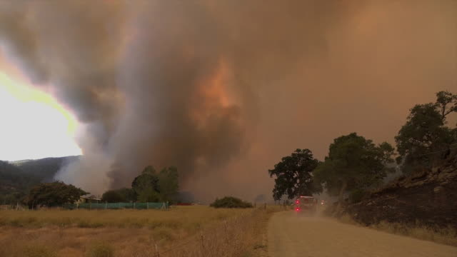 firetruck heads down a road to battle wildfires in mendocino county, california on august 5, 2018. - fire engine stock videos & royalty-free footage