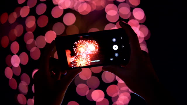 firework and smartphone with beautiful bokeh - firework display stock videos & royalty-free footage