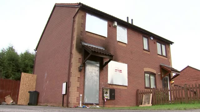 family appeal for further information Birmingham Firedamaged house Flowers and handwritten messages outside house
