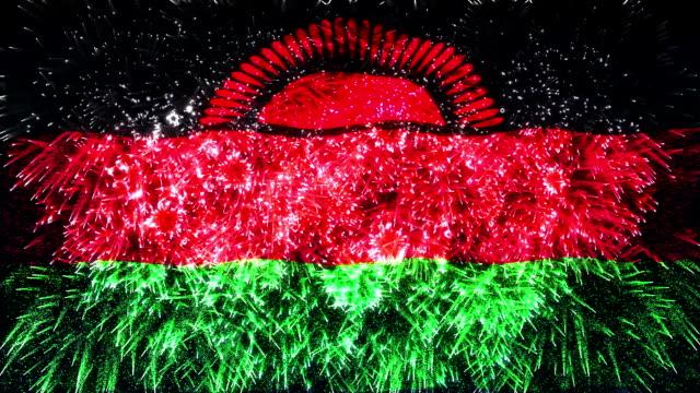 vídeos de stock e filmes b-roll de fogo de artifício bandeira de malawi - malávi